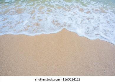 Empty sand beach with wave background. Summer Vacation Travel and Holiday concept