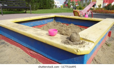 Empty sandbox on the children playground in autumn