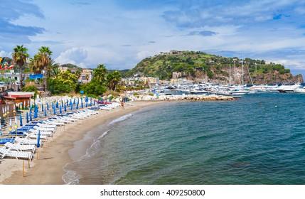 Empty sandy beach of Lacco Ameno, Ischia island, Italy