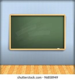 empty school blackboard at blue wall in interior with wooden floor