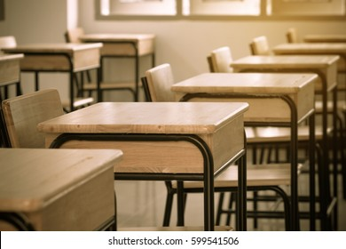 Empty of School classroom with desks chair wood, and blackboard in high school Thailand, vintage tone education concept