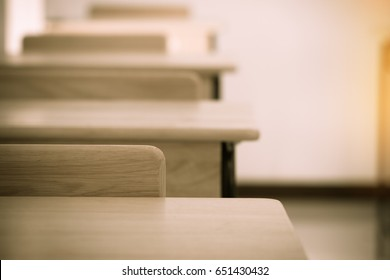 Empty School classroom with desks chair wood, and blackboard in high school thailand, vintage tone education concept