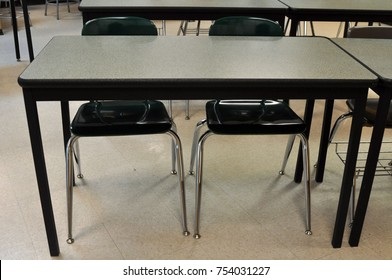 Empty School Desk with Two Chairs