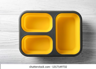 Empty school lunch box on wooden background