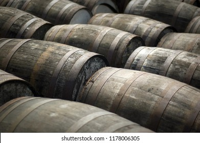 Empty Scotch whisky barrels await filling outside a distillery in Scotland. These barrels would have been originally used for bourbon and other American whiskies.