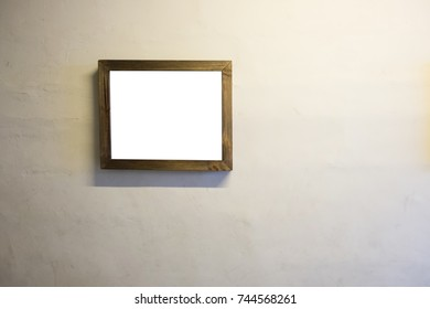 Empty screen display of photo frame on wall.