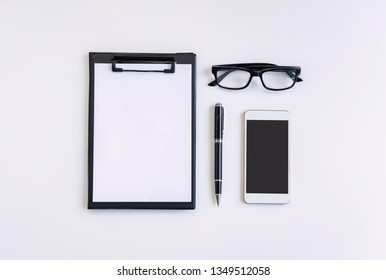 Empty screen Smart phone and file folder on business desk office with copy space, Top view