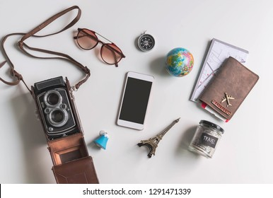 Empty screen smart phone with travel accessories and items on white background with copy space, Travel concept