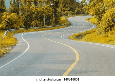 An empty S-Curved road on natural skyline drive.