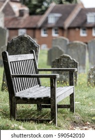 Empty seat in a church graveyard, sadness metaphor