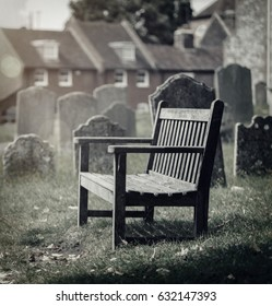 Empty seat in a graveyard with sunlight filter