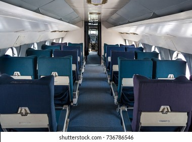 Empty seat rows in commercial old aircraft cabin
