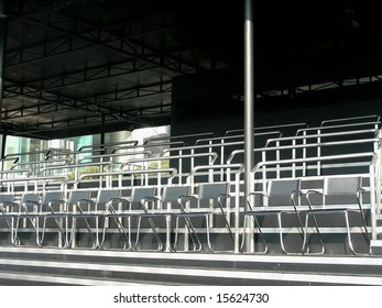 Empty seats in the audience area at an outdoor