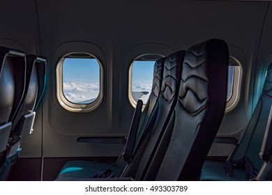 Empty seats inside a flying aircraft