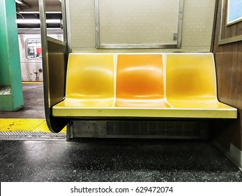 Empty seats in a NYC subway car.