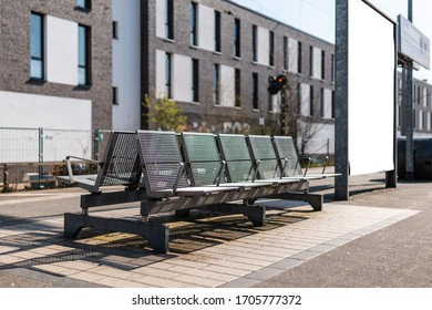 Empty seats on on empty trainstation in sunny weather