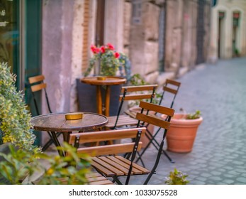 Empty seats at small cafe in Europe.
