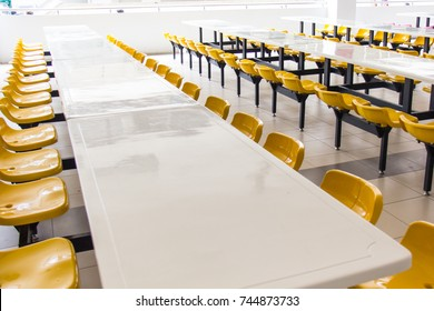 Empty seats and tables in the clean cafeteria at the elementary school.