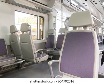 Empty seats in train wagon indoor. Interior of the high-speed train.