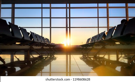 empty seats waiting for landing in the airport terminal at sunset
