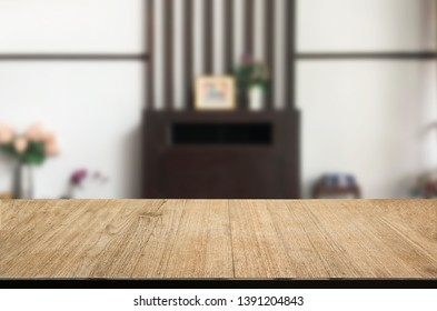 Empty Selected focus wooden table with bokeh  blurred background  restaurant free space for decoration display or montage product can be used.