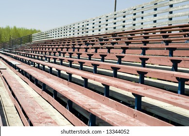 An empty set of school benches, used for watching sporting events