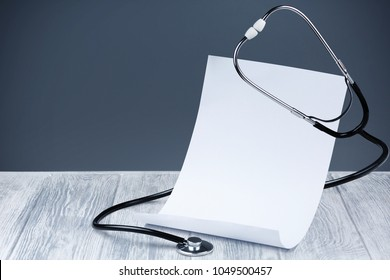 empty sheet on the table with a stethoscope, doctor's day, doctor's desk, medical concept for the day of fighting diseases