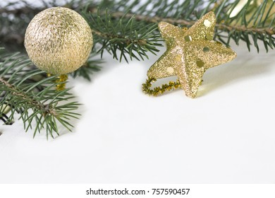 an empty sheet of paper decorated with Christmas-tree golden toys close