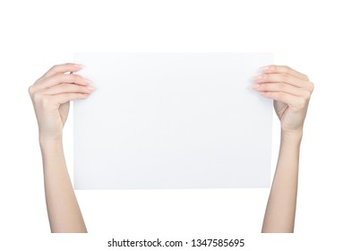 Empty sheet of paper in female hands with manicure isolated on white