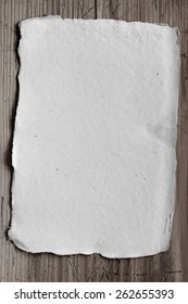 empty sheet of paper on wooden background