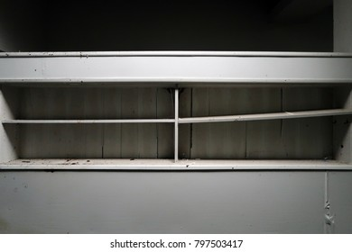 Empty shelves in an abandoned house. Natural light.