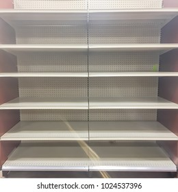 Empty shelves at grocery store in America. Supermarket with empty shelves for goods.
