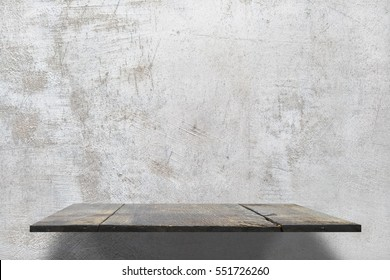 empty shelves on concrete wall.