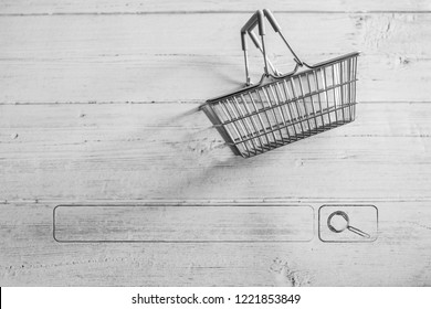 empty shopping basket with search bar underneath, concept of shopping online and finding the right products