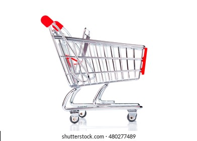 Empty shopping cart closeup on white background