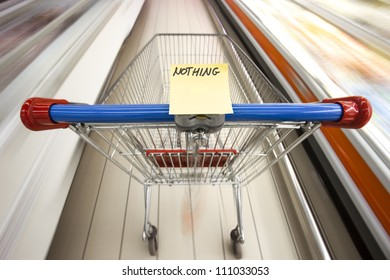 An empty shopping cart in motion in a supermarket - empty shopping list