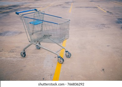 Empty Shopping Cart Supermarket Trolley in Parking Lot of Retail Store Shopping Mall at End of Year Sale concept of Recession or Economic Stagnation Background of Business Decreased Sales Copyspace