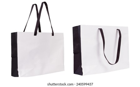Empty Shopping Paper Bag isolated on white background for advertising and branding.
