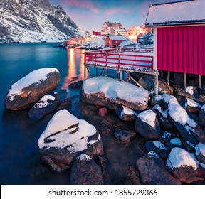 Empty shore of famous Nusfjord town on Lofoten Islands. Amazing sunset on Norway, Europe. Wonderful evening seascape of Norwegian sea.  Life over polar circle.