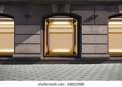 empty show window of shop, city street at night