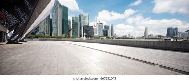empty sidewalk with modern buildings in singapore