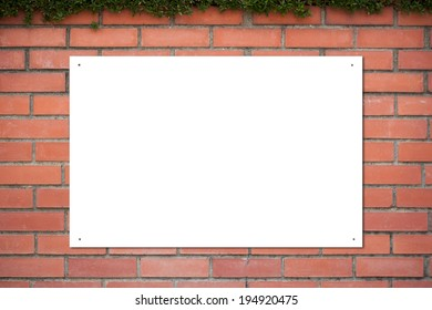 Empty sign board on the brick wall