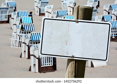 Empty signboard with copy space in front of beach chairs on the beach of the Baltic Sea in Germany