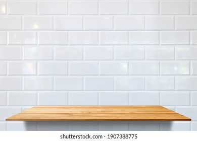 Empty single wood plank shelf at white ceramic tile wall pattern background. Mock up for display or montage of product or design.