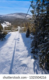 Empty ski lift in the mountains at sunny day