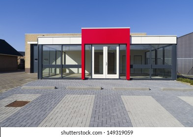 empty small office building with red entrance