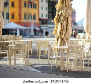 Empty small outdoor restaurant tables in the city of Lerici, La Spezia, Italy
