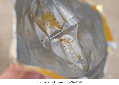 Empty snack bag in top view,french fries scraps in snack bag.