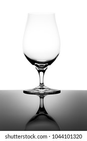 Empty Snifter Tasting Glass and Reflection Isolated on White Background