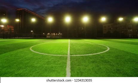 empty soccer field with spot light at night, green football court for futsal training